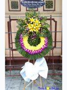 Đặt vòng hoa đám tang tphcm hoa lan tím lan vàng tại Hà Nội
